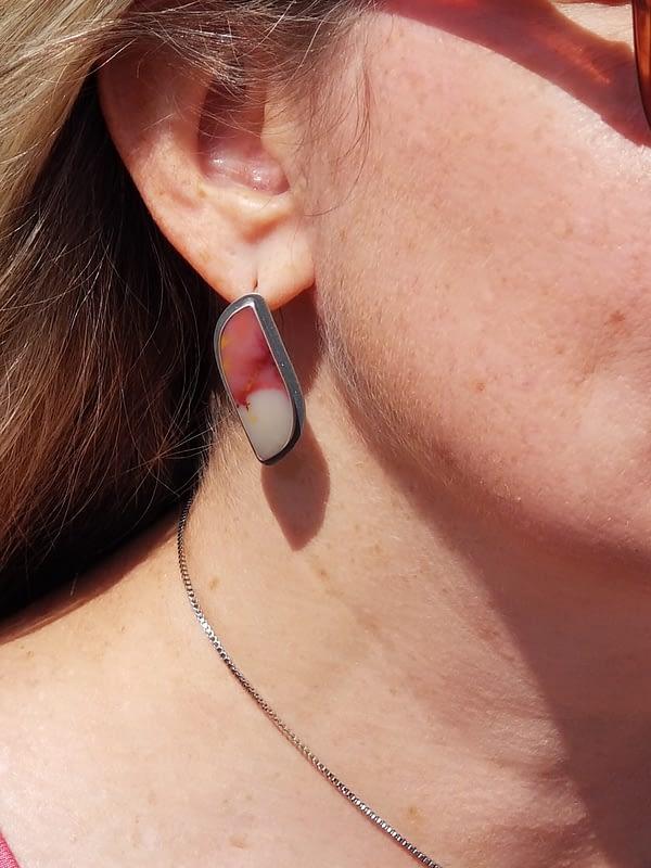 Woman wearing orange earrings