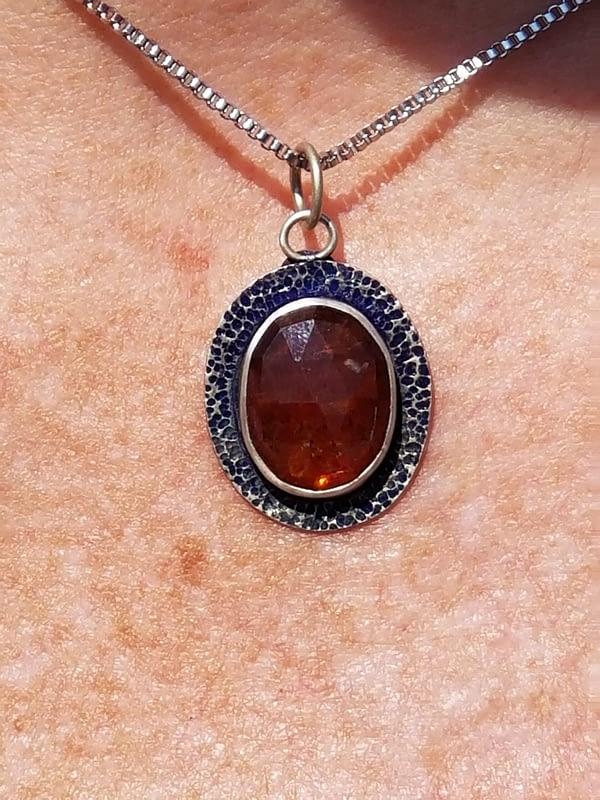 Woman wearing orange necklace