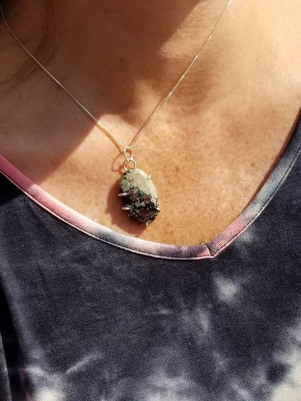 Woman wearing black and red stone necklace